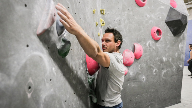 man climbing at boulder wall